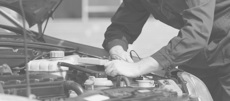 A diesel mechanic's hands work on a diesel engine.